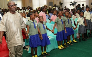 2014 CHILDREN'S DAY:  Governor Emmanuel Uduaghan of Delta State (left) and children from various schools in the State singing the Unity song during a prayer section for adopted Chibok Girls marking the 2014 Children's Day celebration held in Government House, Asaba, Tuesday