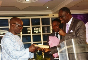 Governor Emmanuel Uduaghan of Delta State (left), receiving a Special Bible from Pastor Odunayo Oke of the Avenue Baptist Church during a church service in Warri.