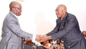 Governor Emmanuel Uduaghan of Delta State (left), congratulating Mr. Pastor Powell Ojogho, shorly after swearing him in as one of the Commissioners in the State Excutive Council in Asaba