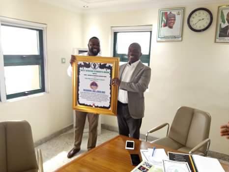 Director of Finance & Accounts, DESOPADEC, Mr. Ajie Louis receiving the Award on behalf of Bashorun Askia Ogieh